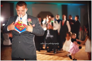 groom, superman, sarasota wedding, teal and coral wedding, van wezel wedding, michael's on east wedding